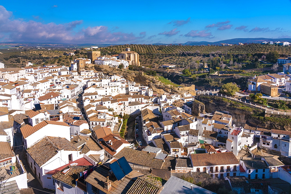 Overview of The Setenil de las Bodegas, with its white historic buildings and the houses under the rock mountain - 1300-209