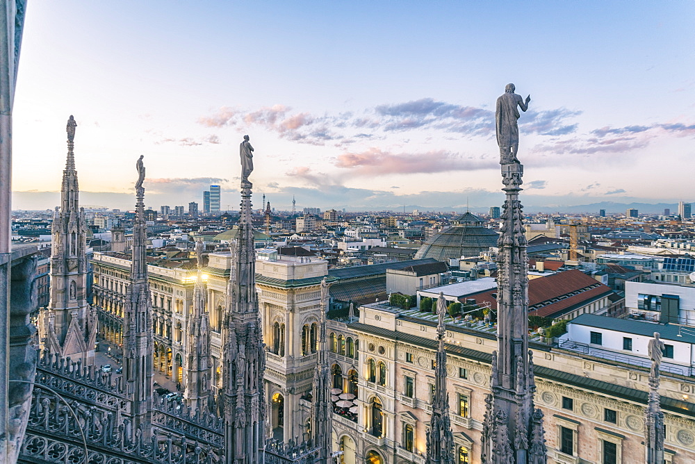 View of the statues on the Cathedral of Milan and the skyline of Milan seen in the background, Milan, Lombardy, Italy, Europe