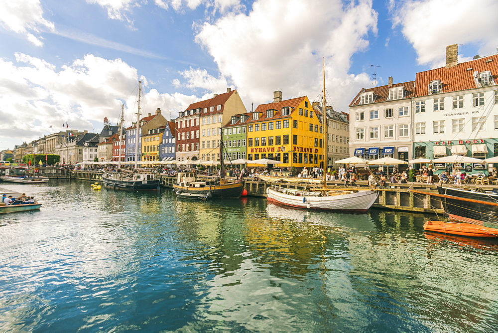 Nyhavn with old colourful houses and boats anchored in summer, Copenhagen, Denmark, Europe