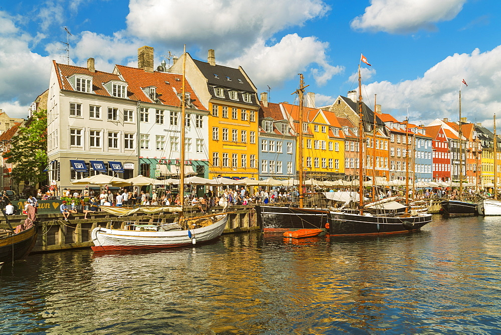 Nyhavn in Kopenhagen with old colorful andhousesboats anchored in summer - 1300-232