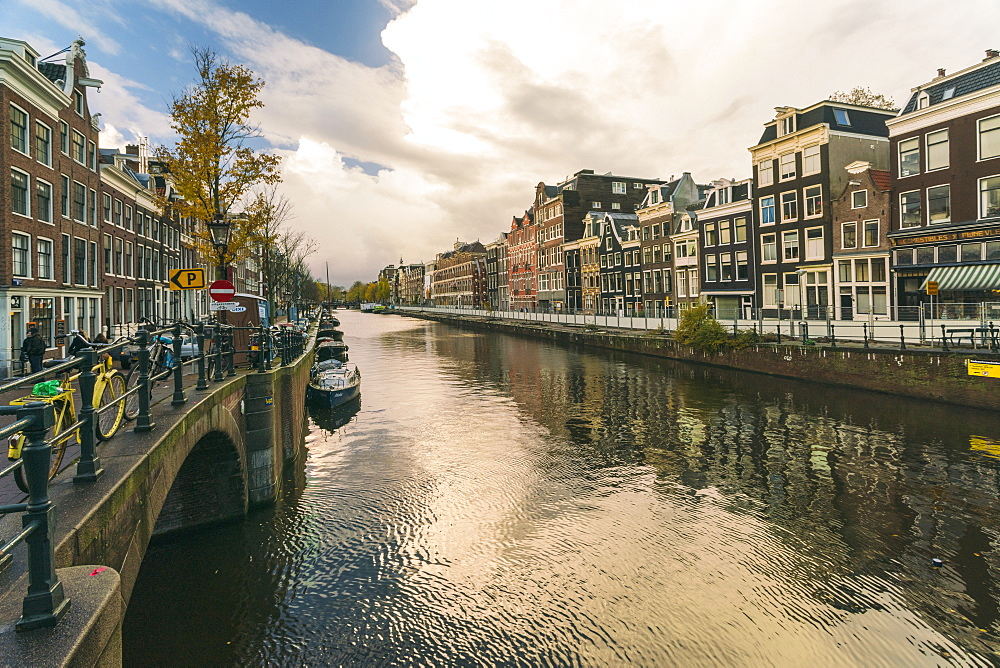 Canal at the historic center of Amsterdam close to the red light district in Autumn - 1300-250