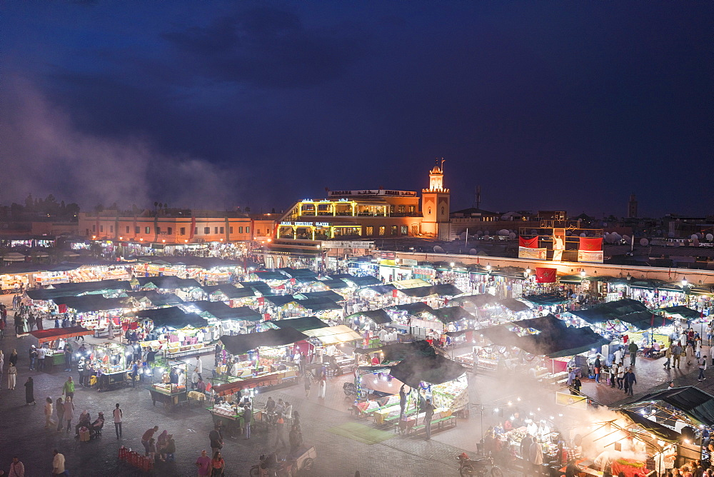 Jemaa el-Fnaa at sunset, bustling market square, UNESCO World Heritage Site, Marrakesh, Morocco, North Africa, Africa