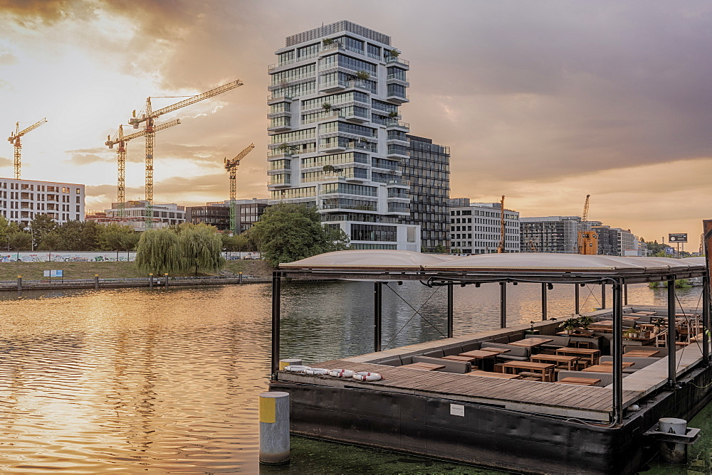 View of the Spree River after sunrise in Berlin with modern buildings in the background, Berlin, Germany, Europe