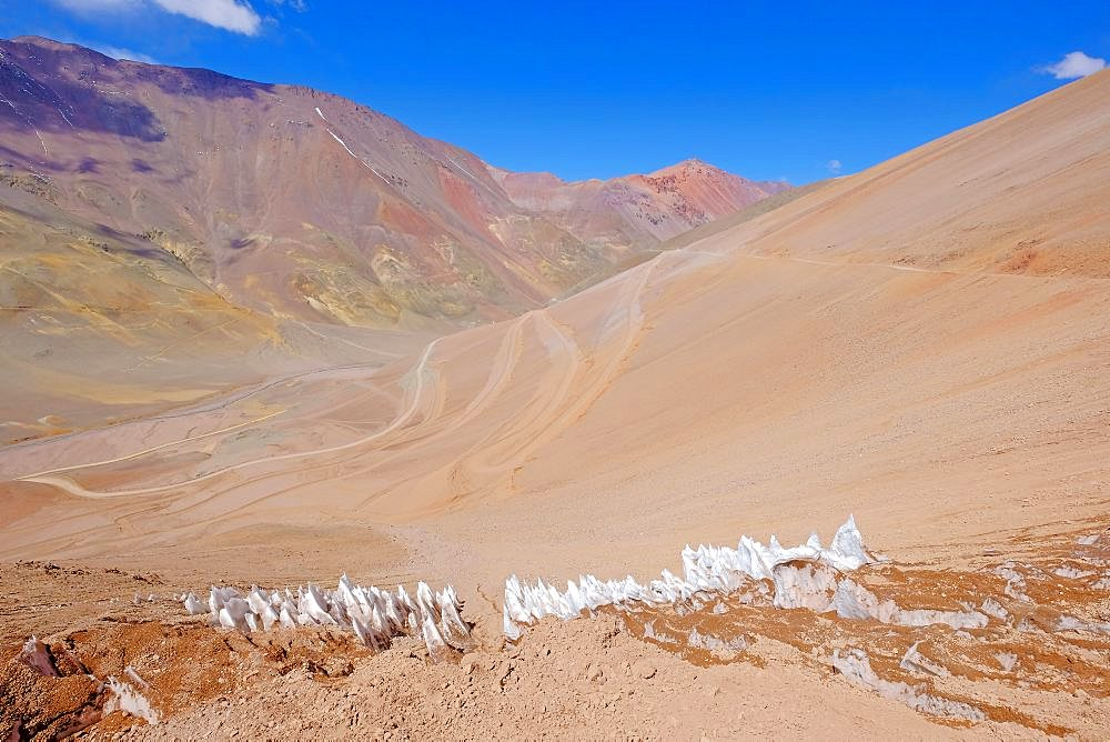 Ice or snow penitentes and the road leading to Paso De Agua Negra mountain pass, Argentina and Chile, South America