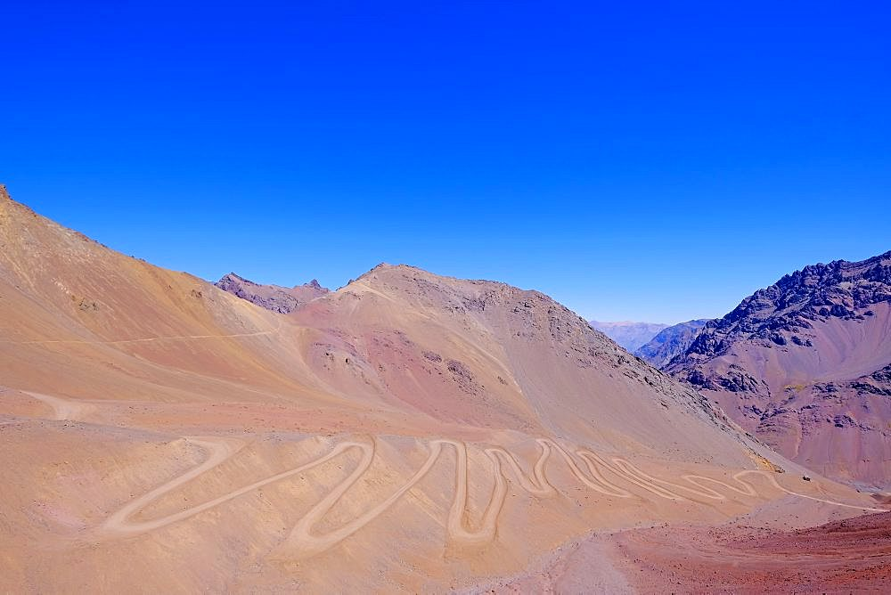 Old dangerous mountain road of the Paso de la Cumbre or Cristo Redentor in the Andes between Argentina and Chile, South America
