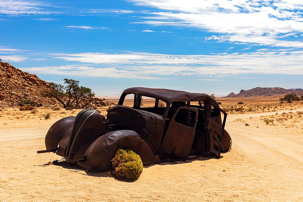 An Abandoned car that was shot down in a Diamond Heist in 1934 within Aus Vista, Namibia, Africa - 1304-28