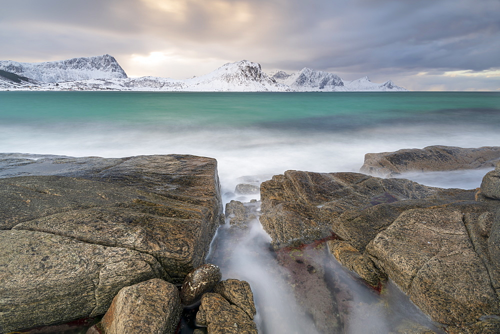 A long exposure at Haukland Beach with moody sky, Lofoten, Nordland, Arctic, Norway, Europe