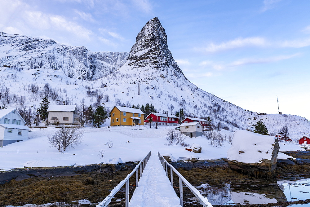 Pointed mountain of Reine with footbridge in winter, Reine, Lofoten, Nordland, Arctic, Norway, Europe