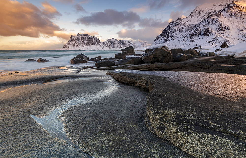 Dramatic rock formation in winter at Haukland Beach, Lofoten, Nordland, Norway, Europe