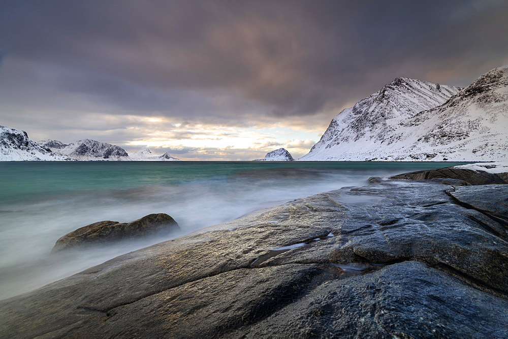 Rock formation in winter at Haukland Beach, Lofoten, Nordland, Norway, Europe
