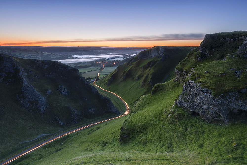 Winnats Pass at sunrise with car light trails, Winnats Pass, Hope Valley, Peak District, Derbyshire, England, United Kingdom, Europe