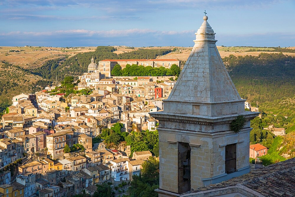 View over sunlit Ragusa Ibla, evening, bell-tower of the Church of Santa Maria delle Scale in foreground, Ragusa, UNESCO World Heritage Site, Sicily, Italy, Europe