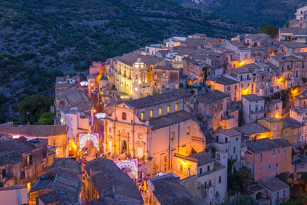View over illuminated Ragusa Ibla, dusk, streets decorated to mark the Festival of San Giorgio, Ragusa, UNESCO World Heritage Site, Sicily, Italy, Europe