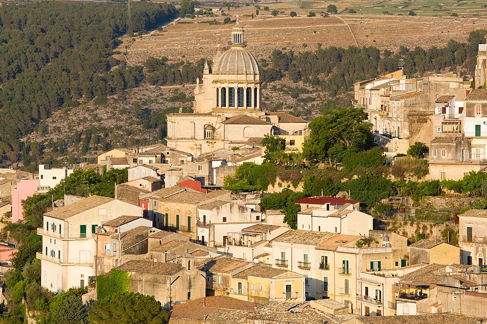 View over the sunlit rooftops of Ragusa Ibla, evening, dome of the Cathedral of San Giorgio prominent, Ragusa, UNESCO World Heritage Site, Sicily, Italy, Europe - 1310-130
