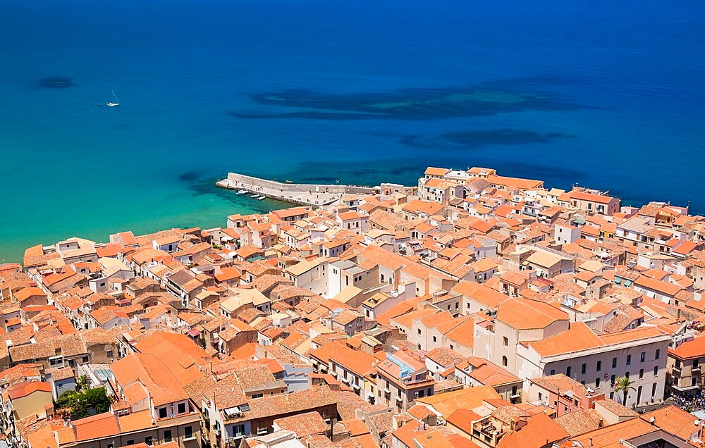 View over the colourful tiled rooftops of the Old Town from La Rocca, Cefalu, Palermo, Sicily, Italy - 1310-133