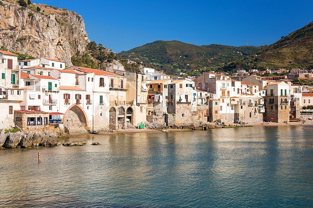 View across harbour to the Old Town, houses clustered together along waterfront, Cefalu, Palermo, Sicily, Italy - 1310-134