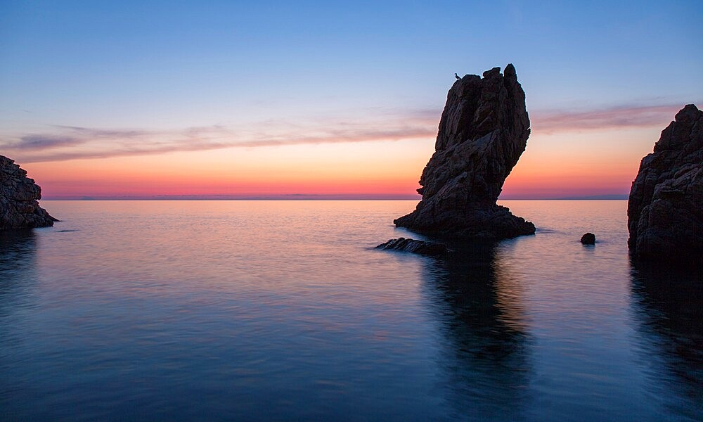 View from Calura Bay across the Tyrrhenian Sea, dawn, rock stack silhouetted against red sky, Cefalu, Palermo, Sicily, Italy, Mediterranean, Europe - 1310-138
