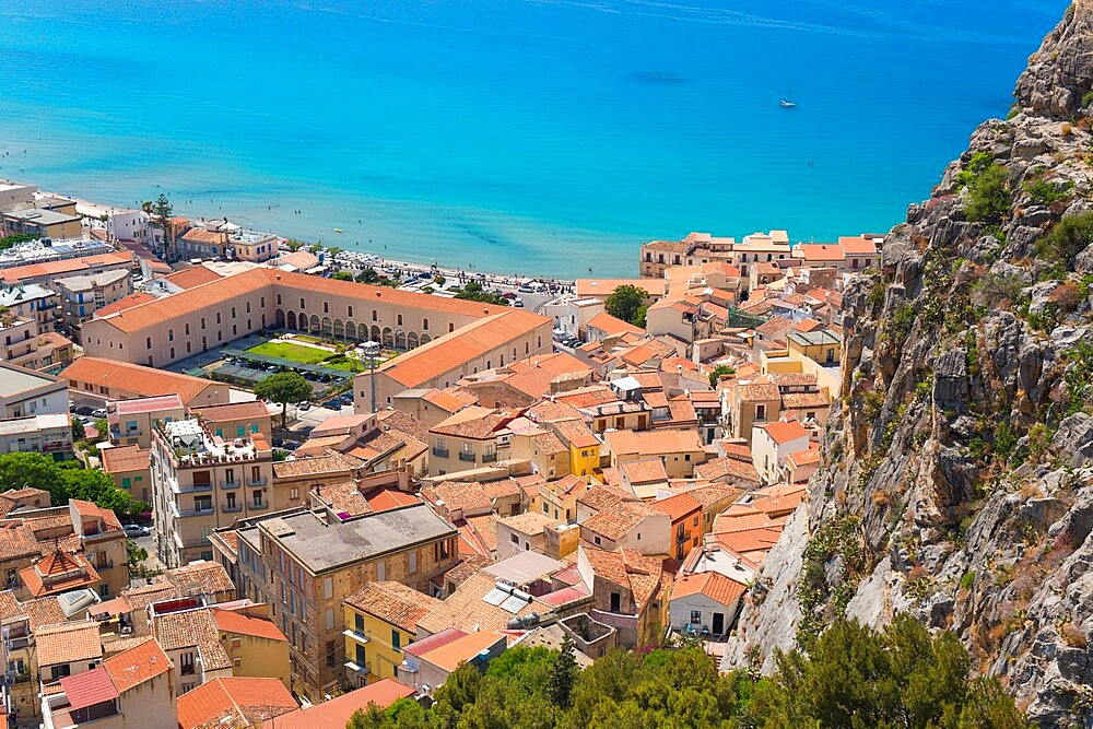 View from La Rocca over tiled rooftops to the calm turquoise waters of the Tyrrhenian Sea, Cefalu, Palermo, Sicily, Italy - 1310-139