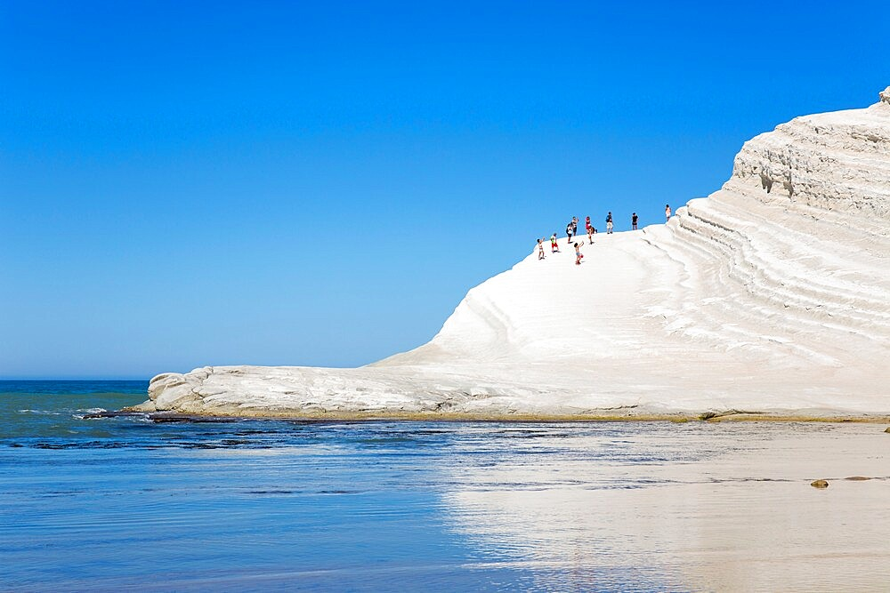 View across calm sea to the white limestone cliffs of the Scala dei Turchi, Realmonte, Porto Empedocle, Agrigento, Sicily, Italy - 1310-140