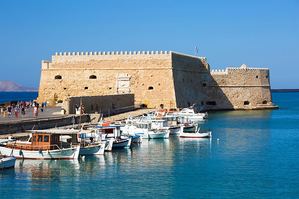 View across the Venetian Harbour, boats moored in front of the Koules Fortress, Iraklio (Heraklion), Crete, Greek Islands, Greece, Europe