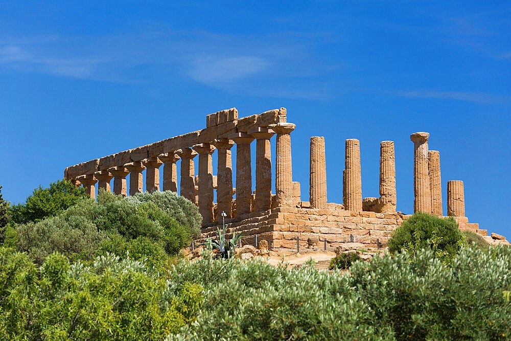 View over trees to the hilltop Temple of Hera, aka Juno, in the UNESCO listed Valley of the Temples, Agrigento, Sicily, Italy - 1310-162