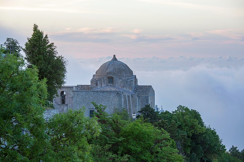 The hilltop Church of San Giovanni Battista, low cloud obscuring the landscape beyond, Erice, Trapani, Sicily, Italy