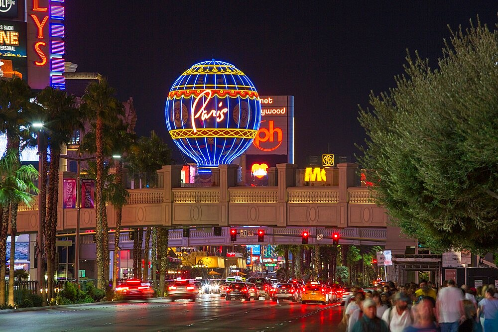 View along The Strip by night, illuminated Montgolfier balloon promoting the Paris Hotel and Casino, Las Vegas, Nevada, United States of America, North America - 1310-211