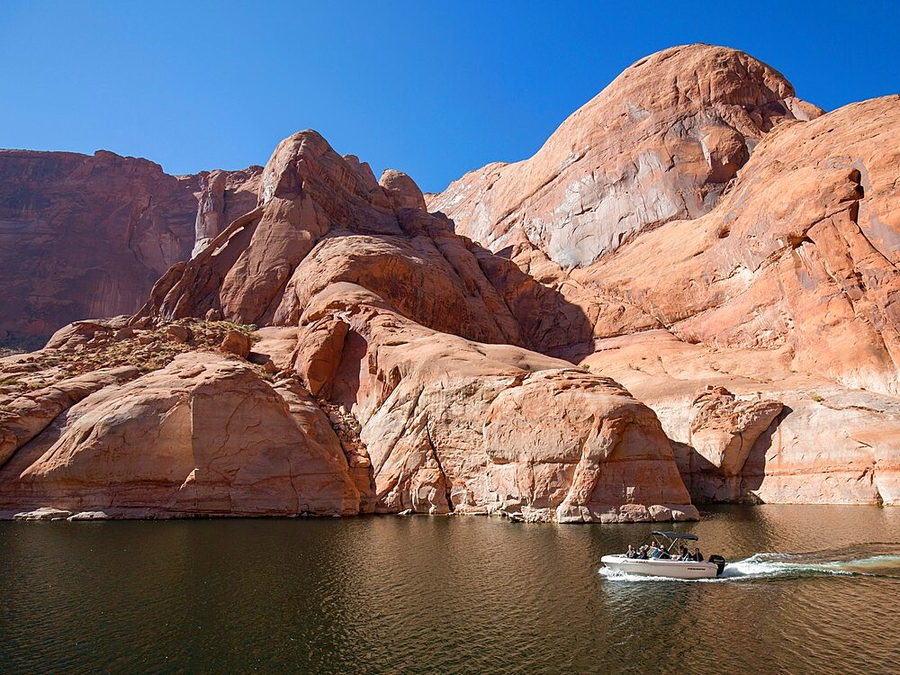 Small pleasure boat in Forbidding Canyon, a narrow arm of Lake Powell, Glen Canyon National Recreation Area, Utah, United States of America, North America - 1310-225