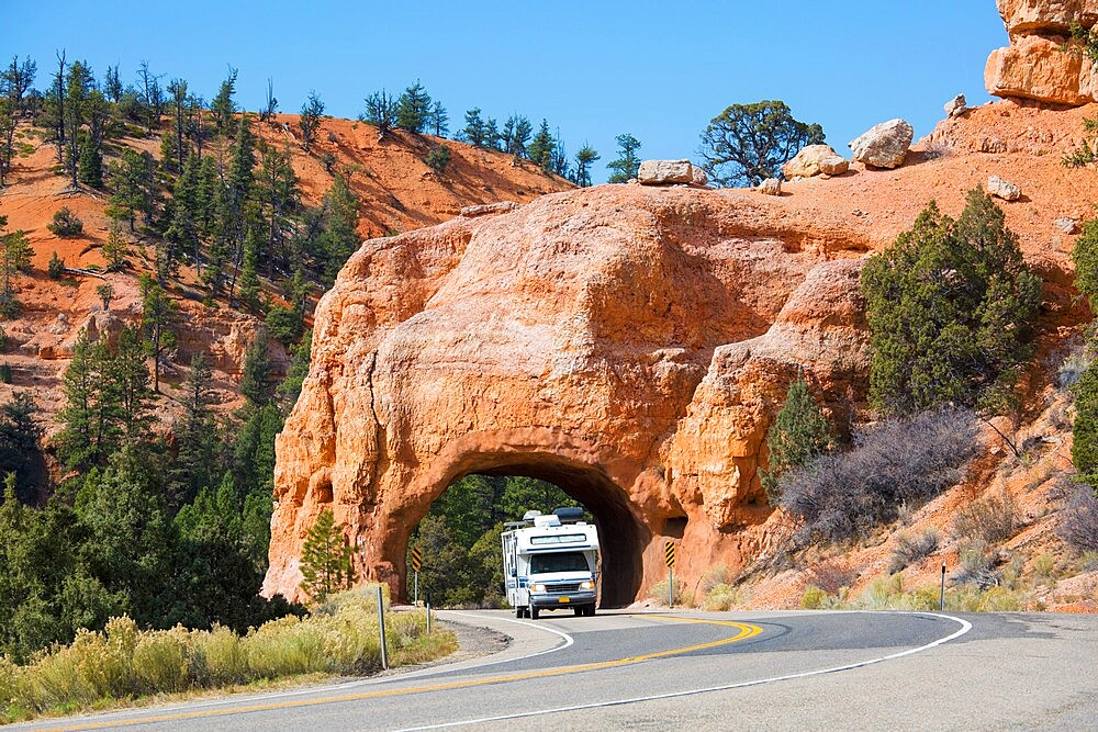 Motorhome emerging from red rock tunnel on Utah State Route 12, Red Canyon, Dixie National Forest, Utah, United States of America, North America - 1310-237