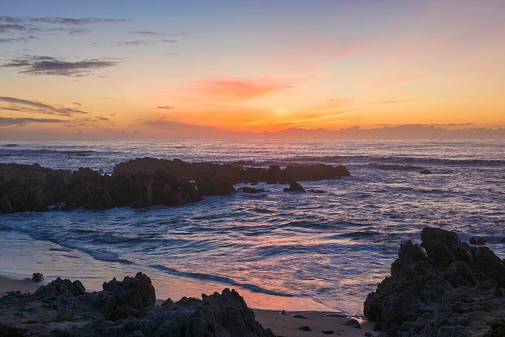 View across the Pacific Ocean from rocky coastline of the Monterey Peninsula, sunset, Pacific Grove, Monterey, California, USA - 1310-249