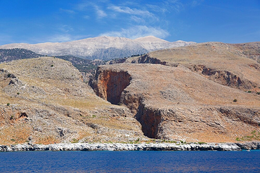 View from sea to the Aradena Gorge and distant peaks of the Lefka Ori, Loutro, Hania (Chania), Crete, Greek Islands, Greece, Europe