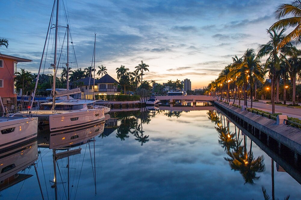View along tranquil canal at dawn, yachts reflected in still water, Nurmi Isles, Fort Lauderdale, Florida, USA - 1310-262