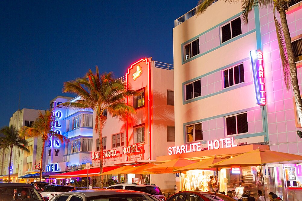 Colourful hotel facades illuminated by night, Ocean Drive, Art Deco Historic District, South Beach, Miami Beach, Florida, USA - 1310-268