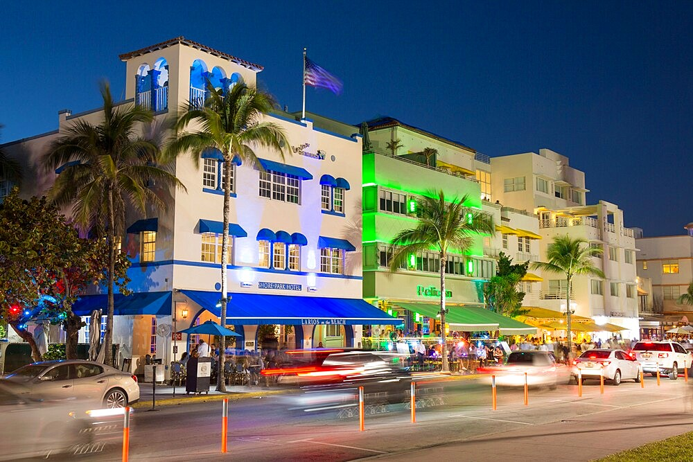 Colourful hotel facades illuminated by night, Ocean Drive, Art Deco Historic District, South Beach, Miami Beach, Florida, USA - 1310-269