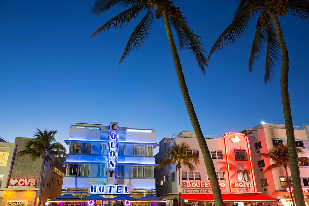 Colourful hotel facades illuminated by night, Ocean Drive, Art Deco Historic District, South Beach, Miami Beach, Florida, USA - 1310-270