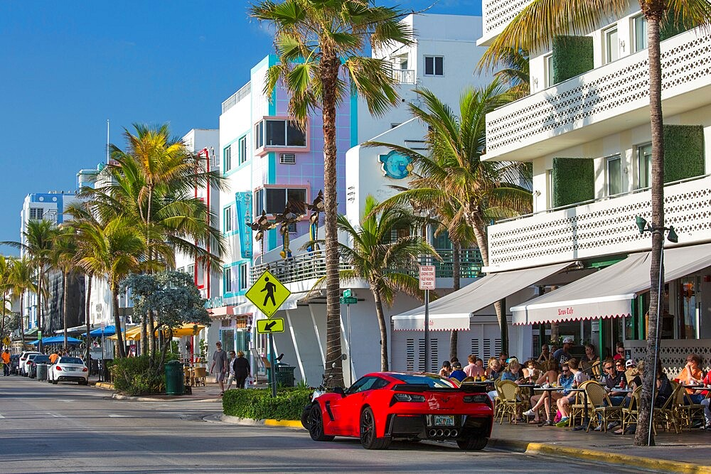 View along Ocean Drive, red Chevrolet Corvette prominent, Art Deco Historic District, South Beach, Miami Beach, Florida, USA - 1310-278