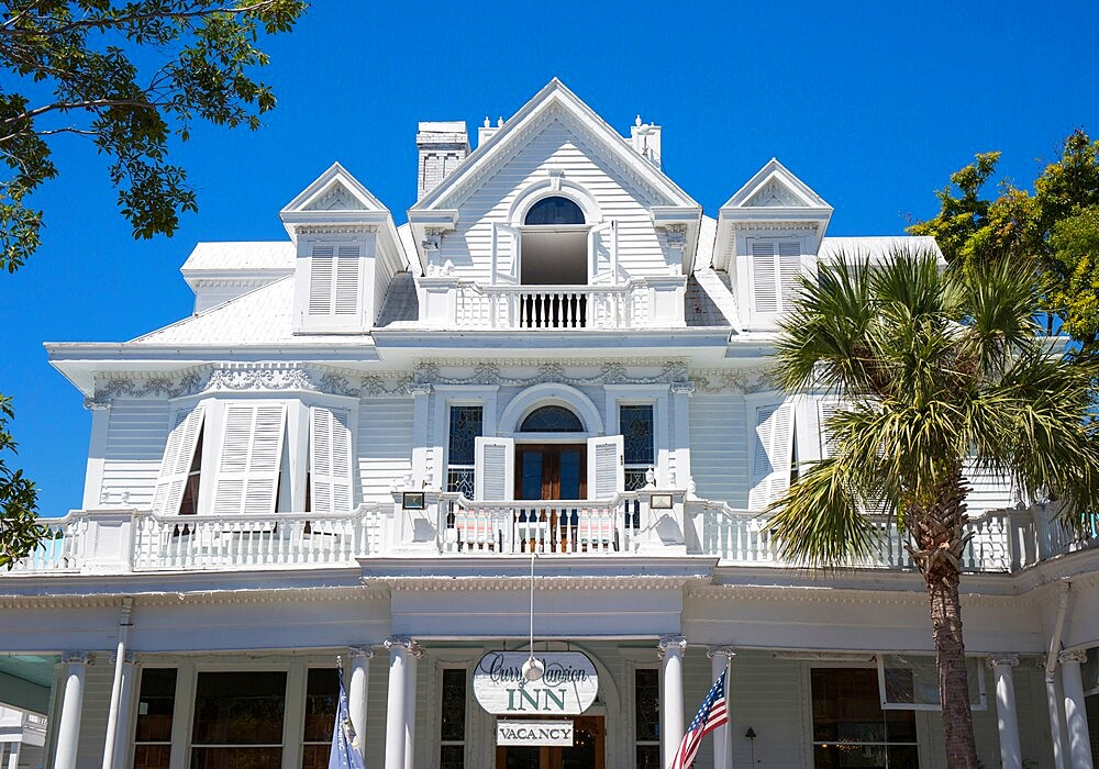 Brilliant white facade of the historic Curry Mansion, now a guest house, Old Town, Key West, Florida Keys, Florida, USA - 1310-284