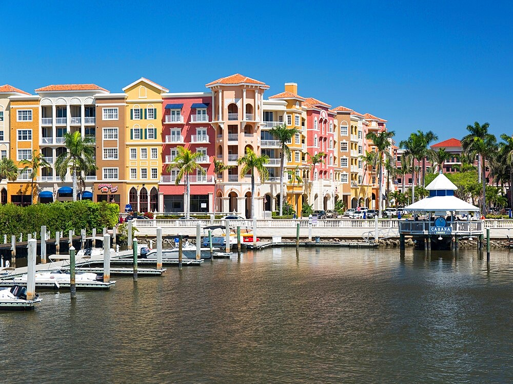 View across the Gordon River to the colourful architecture of Bayfront Place, Naples, Florida, USA - 1310-288