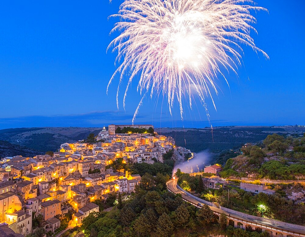 View over Ragusa Ibla, dusk, fireworks marking the Festival of San Giorgio, Ragusa, UNESCO World Heritage Site, Ragusa Province, Sicily, Italy, Europe