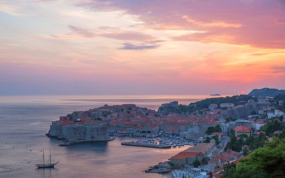 View over the Old Town, Stari Grad, from hillside above the Adriatic, sunset, Dubrovnik, Dubrovnik-Neretva, Dalmatia, Croatia - 1310-54