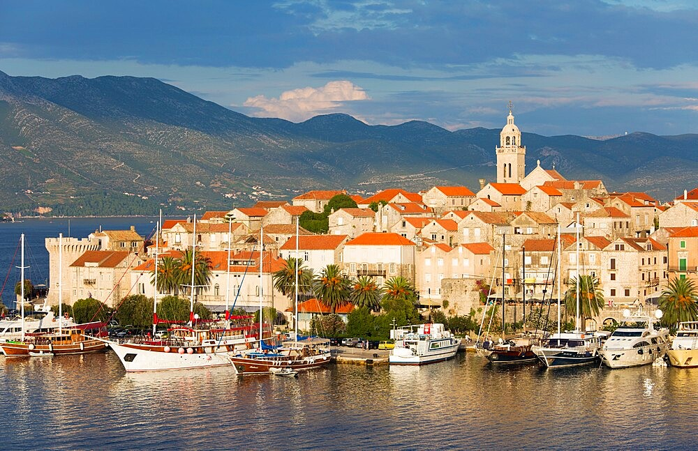 View over harbour to the Old Town, yachts moored beside quay, Korcula Town, Korcula, Dubrovnik-Neretva, Dalmatia, Croatia