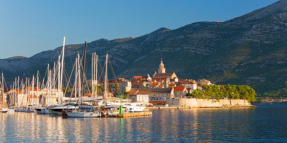 Panoramic view across marina to the Old Town at sunrise, Korcula Town, Korcula, Dubrovnik-Neretva, Dalmatia, Croatia - 1310-59