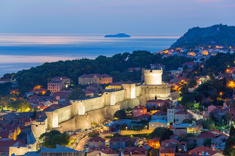 View over the illuminated city walls from above, dusk, the Adriatic Sea beyond, Dubrovnik, UNESCO World Heritage Site, Dubrovnik-Neretva, Dalmatia, Croatia, Europe