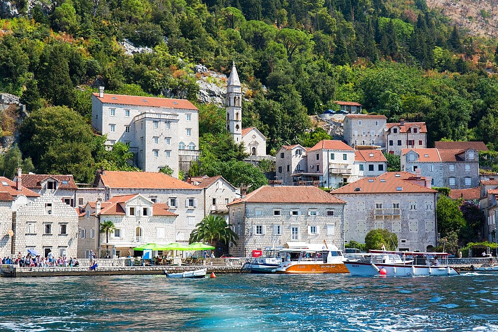 View from sea to historic waterfront mansions overlooking the Bay of Kotor, Perast, Kotor, Montenegro
