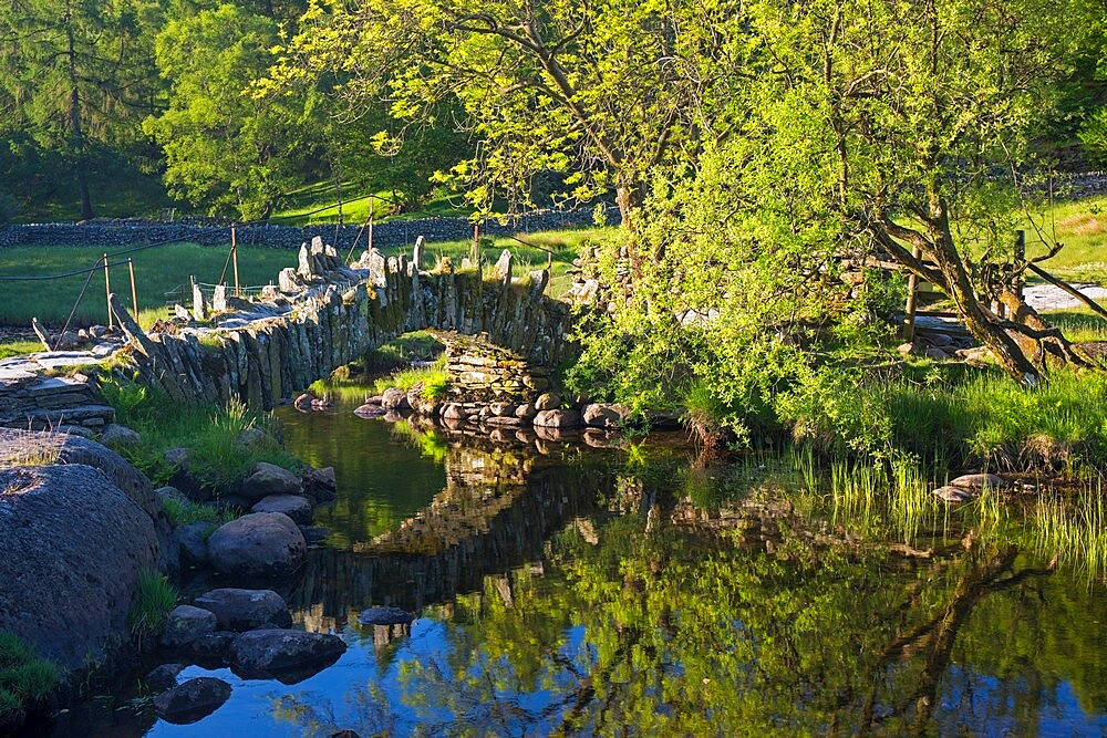 16th century Slater's Bridge reflected in the River Brathay, Little Langdale, Lake District National Park, UNESCO World Heritage Site, Cumbria, England, United Kingdom, Europe