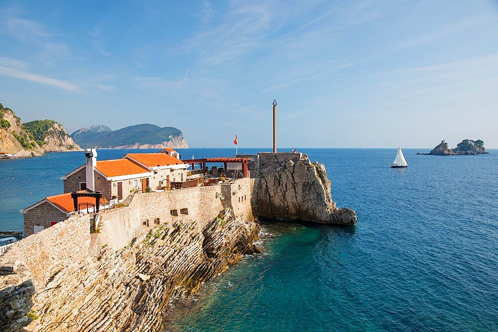 View along cliffs to 16th century Venetian fortress overlooking the Adriatic Sea, Petrovac, Budva, Montenegro, Europe