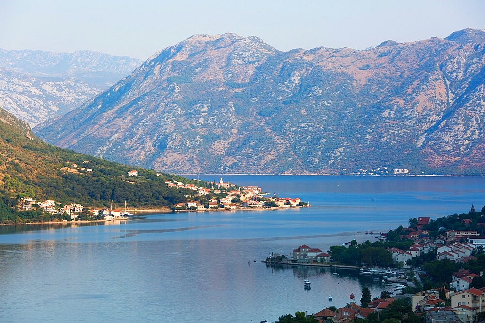 View over the Bay of Kotor from the town walls, early morning, the village of Prcanj prominent, Kotor, UNESCO World Heritage Site, Montenegro, Europe