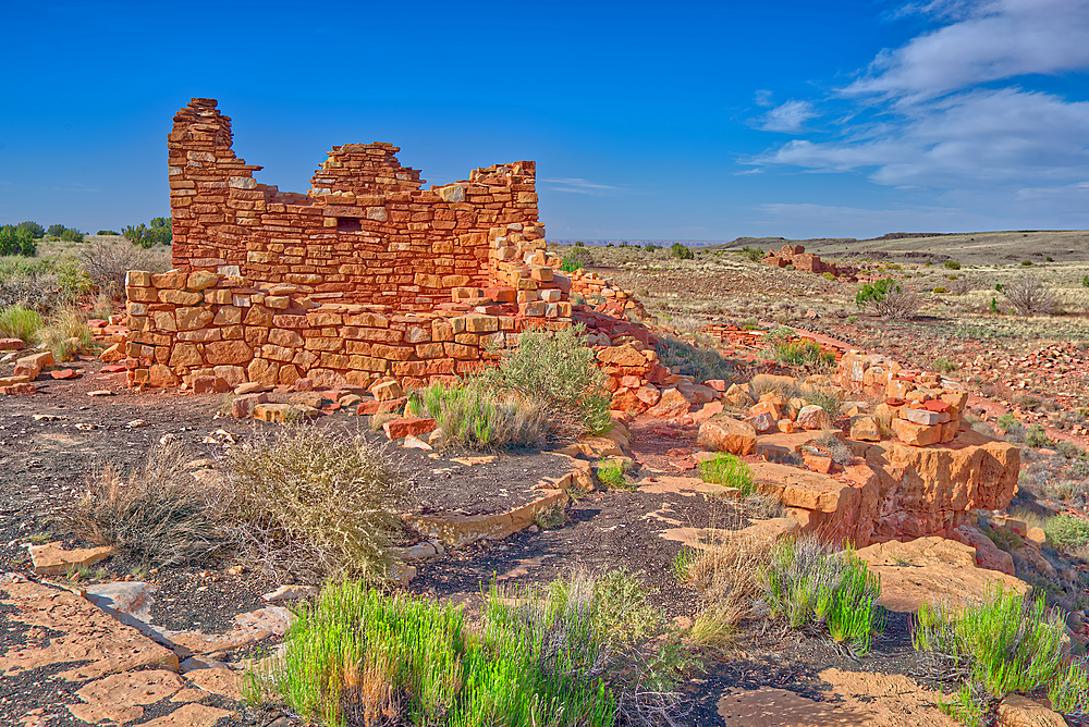 Box Canyon Indian Dwelling with the Lomaki Pueblo ruins in the background. Located in the Wupatki National Monument in Arizona.