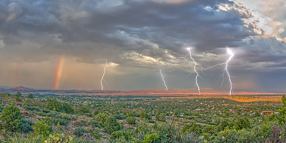 A lightning storm with a rainbow rolling over Mingus Mountain just east of Chino Valley, Arizona, United States of America, North America - 1311-136