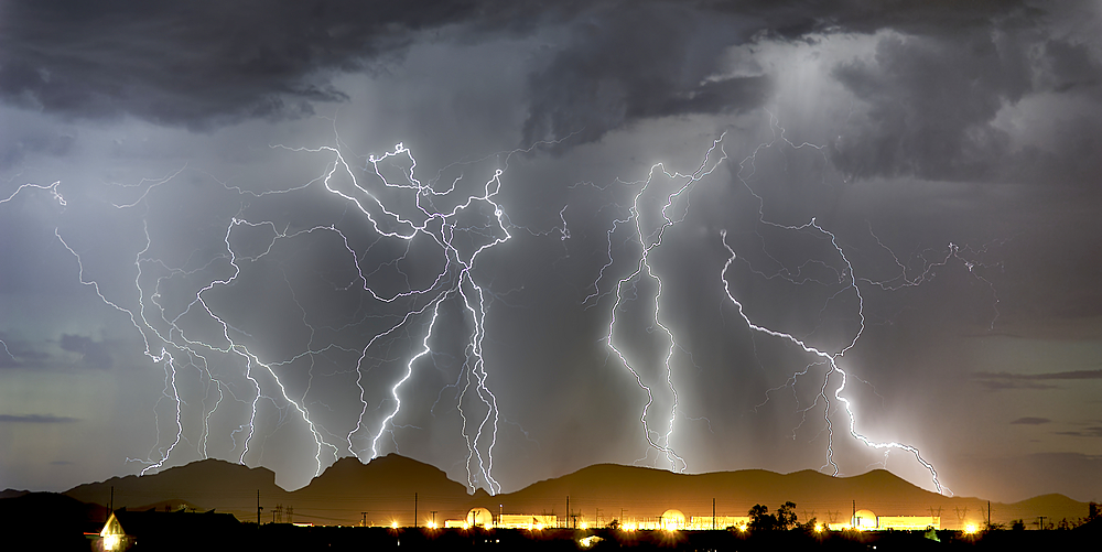 Lightning striking Saddleback Mountain just west of Tonopah, Arizona.